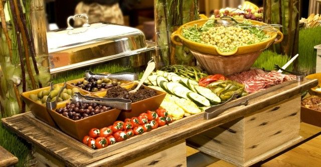 A Beautifully Styled Antipasti Display  Assorted cheese, marinated veggies, asparagus, cured meats, olives, figs, grapes, other fruit, rustic breads/crackers, cheese sticks