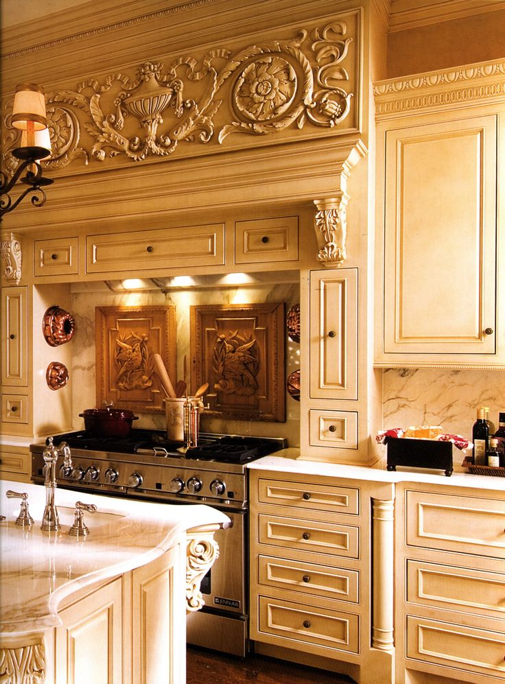 Detailed luxury kitchen with island of a french baroque for Luxury french kitchen