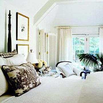 """Create an illusion of larger windows by hanging curtains higher than the window frame. Extend drapery rods beyond the width of the window, so curtain panels don't cover any glass. Dress windows with sheers or tailored panels. White, neutral or pale wall colors reflect light, visually """"pushing back"""" walls. A flat paint recedes more than gloss. Light-colored fabrics unify furniture, preventing rooms from feeling crowded. Light colors allow the bedroom furniture to blend into the background."""