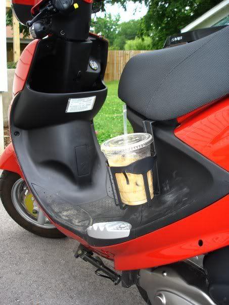 need a cup holder for your scooter. just get a car cup holder and hook it in your seat... why didn't i think of that !
