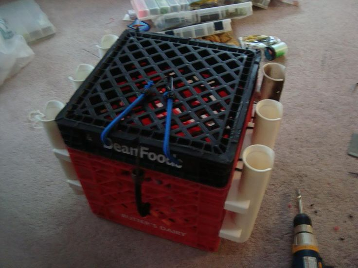 Page 1 of 3 - How too:step by step milk crate with lid instructionsPosted: Tue Nov 10, 2009 4:56 pm - posted in Kayaking and Kayak Fishing Forum: Ok well for this youre going to need  3 milk crates Drill 2 Bungee cords alot of zip ties Rod Holders    Step one get one of the milk crates and cut along this line seen being cut in the picture  when done cutting the crate should look like this  then put the part of the cut crate with the bottom part facing down like this then drill 3 holes in…