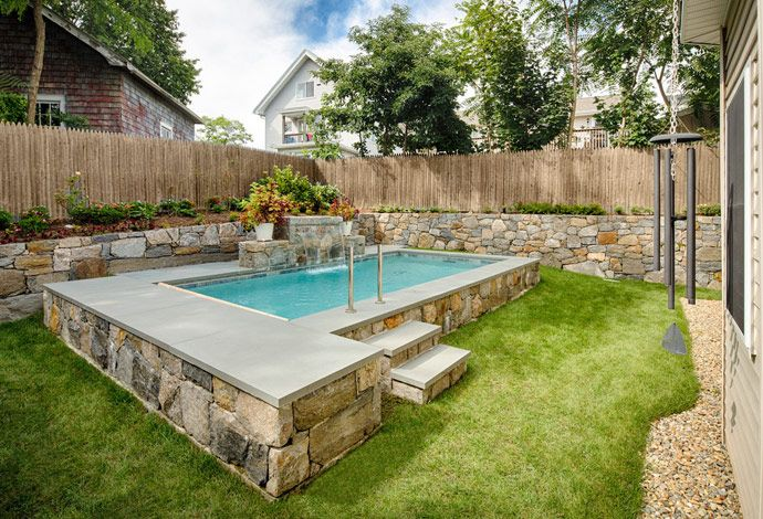 Step it up stone wall surrounds plunge pools for Small backyard pool ideas