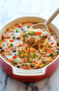 Quinoa Enchilada Casserole - A lightened-up, healthy enchilada bake that you can enjoy guilt-free, chockfull of quinoa, black beans and cheesy goodness!