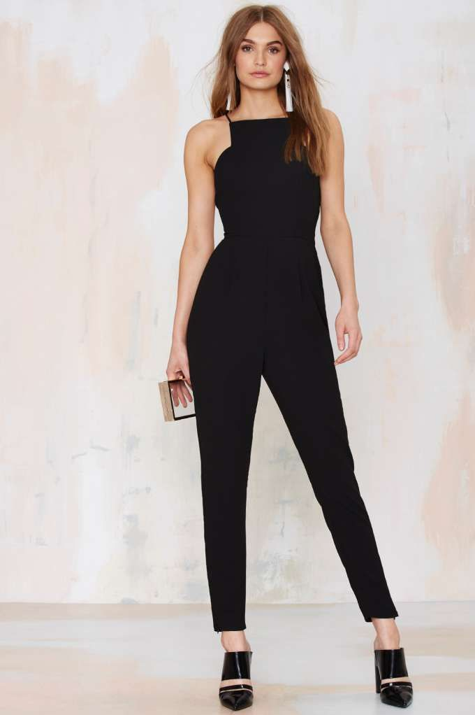 Keepsake Restless Heart Jumpsuit keep's a throwback lookin' modern. This killer black jumpsuit will take you from day to night all summer long.