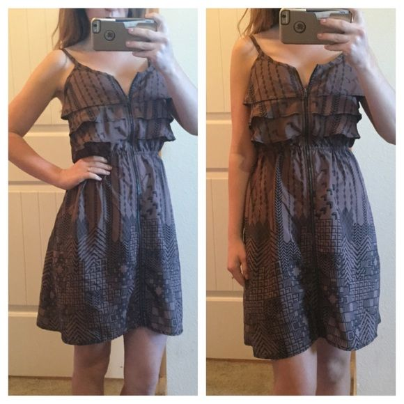 Brown Aztec Zip Up Dress Great condition brown and black dress. Adjustable straps and elastic waist. From top of neckline to bottom is 26 inches. Bust is 15 inches. Waist not stretched is 12 inches. Same day or next day shipping. No trade and no holds. 20% off of bundles. Xhilaration Dresses Mini