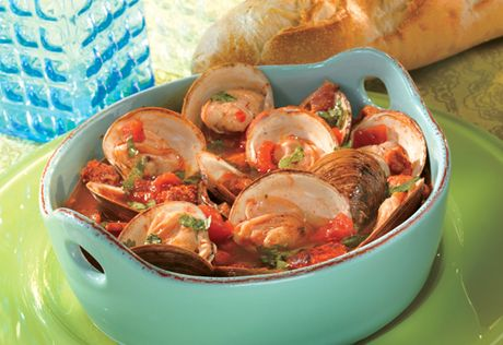 Here's a way to make steamed clams even better. Steam the clams in a savory blend of chicken broth, white wine and diced tomatoes, accented with bacon, chorizo and garlic. It's easy and really good!
