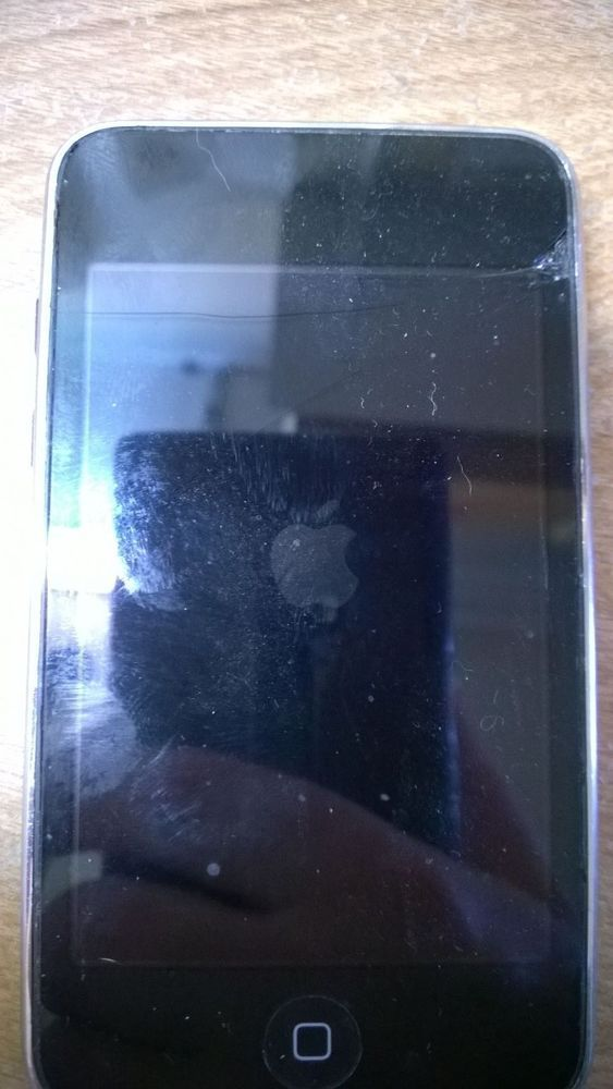 IPod 2 8GB **cracked screen and God knows what else WITH charging cord and cover #Apple Starting bid:US $9.99