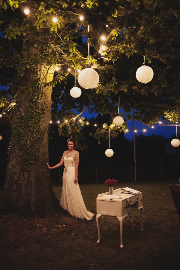 Hanging White Lanterns In Trees Or In Coach House