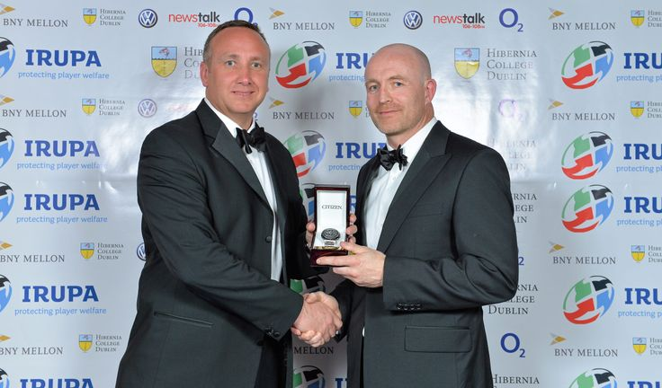 The BNY Mellon IRUPA Hall of Fame Inductee 2013 Denis Hickie receives his award from Alan Flanagan