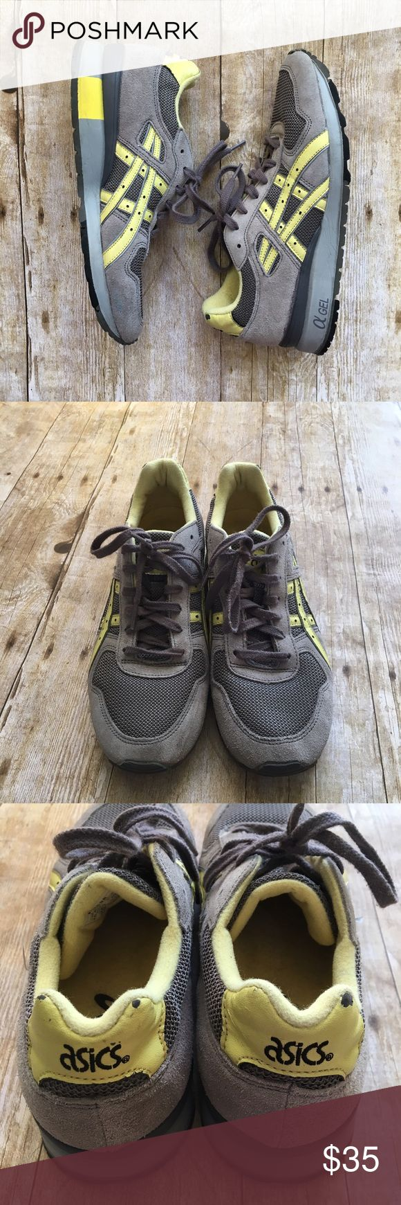 Asics sneakers Comfortable sneaker in grey and yellow colors. Some wear on the top back of sneaker, where some yellow came off {see photo}  bottom of shoes are still in good condition and have good traction.  •Smoke free home•  no trades. Offers welcome : ) Asics Shoes Sneakers