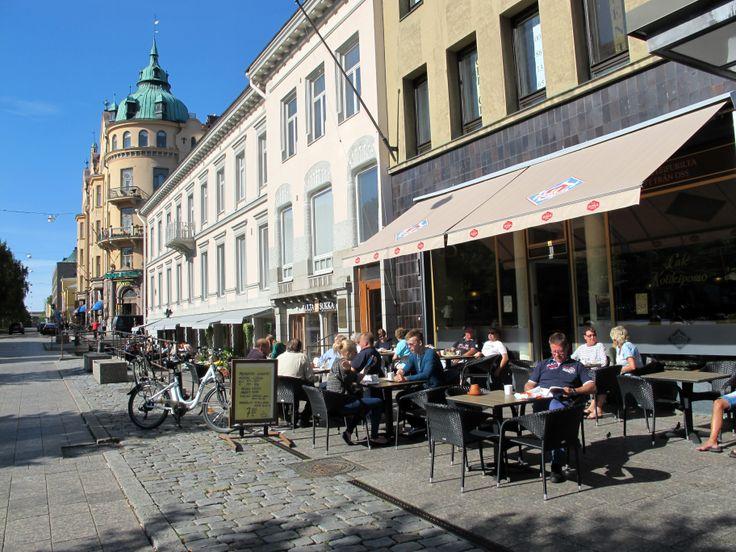 People enjoying summer in sunny Vaasa city centre.