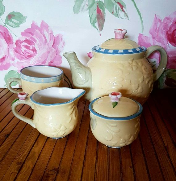 Check out this item in my Etsy shop https://www.etsy.com/uk/listing/466680731/vintage-tea-set-lemon-blue-check-pink