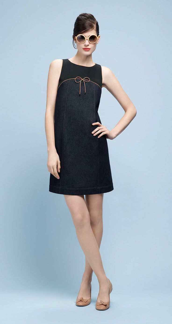 Paule Ka Dual fabric A-line dress with skirt in denim and top in black  neoprene mesh. Bow and finishings in faux leather piping.