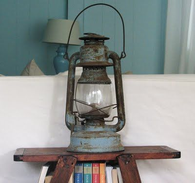 Vintage lantern decorating. one day I want to have a really unique one of a kind booshelf filled with treasures like antique lanterns.