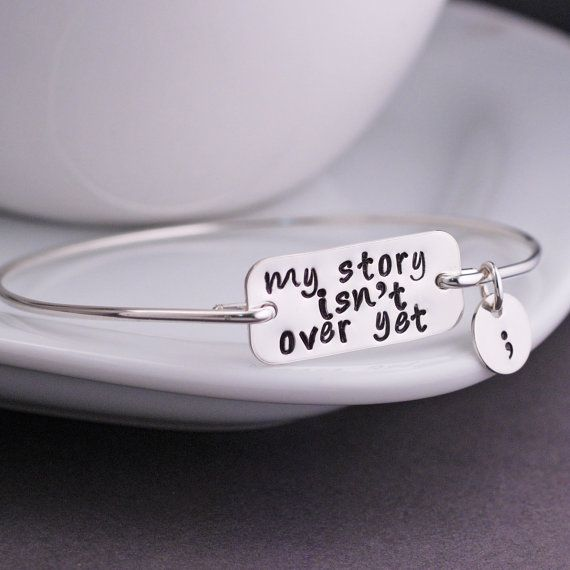 My Story isn't Over Yet Bangle Bracelet by georgiedesigns on Etsy
