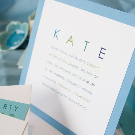 A bright, modern Bat Mitzvah invitation in pool blue and white was created using inspiration from a green and cream Bar Mitzvah invitation in Luscious Verde's Volume II Bar/Bat catalog.