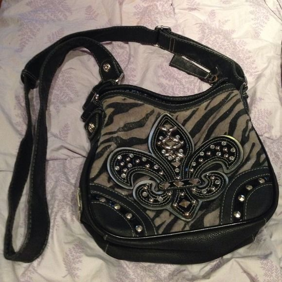 Miss Me purse Side swing miss me purse! A little bit of wear on the back side from use! On of my favorite purses just a little too small for me now! Miss Me Bags