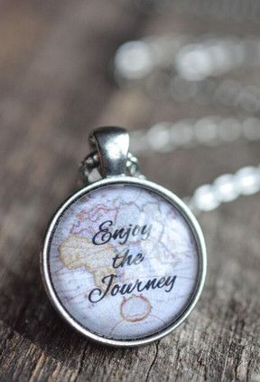"This 24 inch chain quote necklace features a 1 inch pendant with the words ""Enjoy the Journey "" printed on a high quality map image. The pendant has been sealed with a glass dome that magnifies the qu"