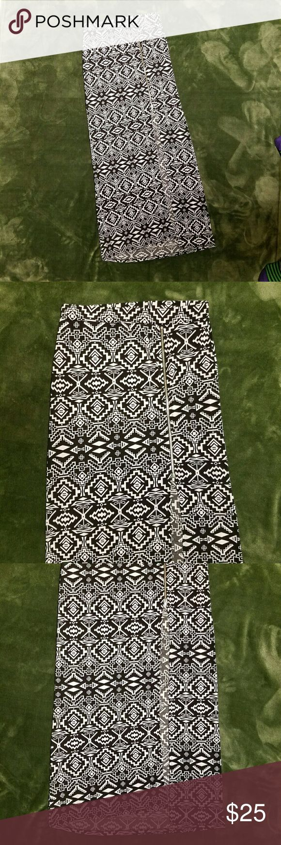 """Sexy Charlotte Russe Bodycon Tribal Maxi Skirt M Sexy Charlotte Russe Bodycon Black White Geometric Abstract Maxi Skirt.  Exposed silver Zipper.  Zipper Stops just above knees.  Tribal geometric print in black and white.   Polyester spandex blend. Hand wash Line dry. Sz M Measures 26"""" waist unstretched to 36"""" stretched,  32"""" hips unstretched,  38"""" overall length. Charlotte Russe Skirts Maxi"""