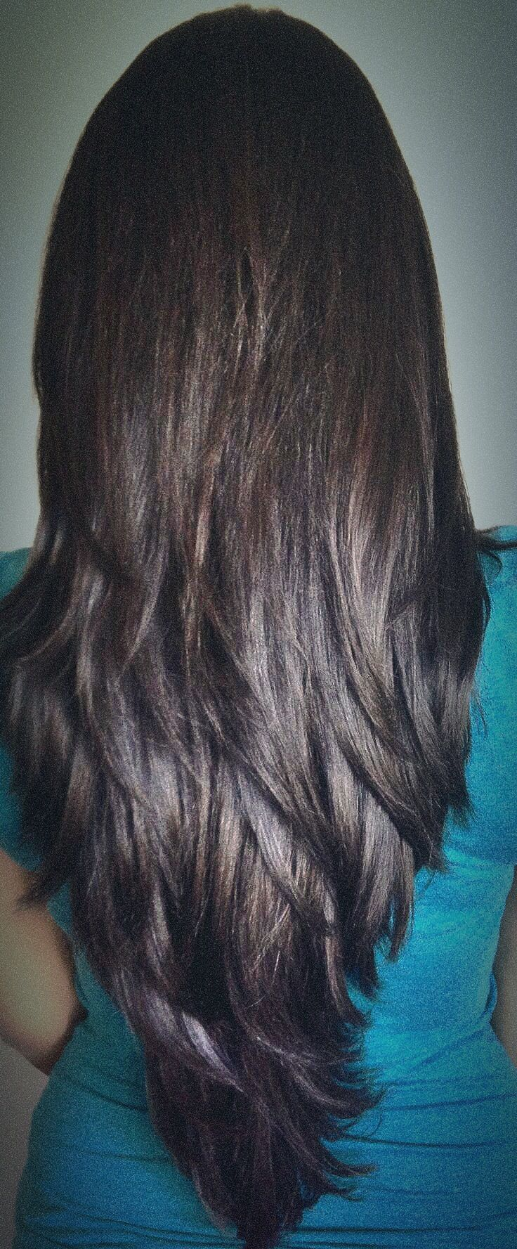 long layered haircut for thick hair cut in long distinct layers which curve naturally for an added textured effect and shape a shattered V-line at the ends