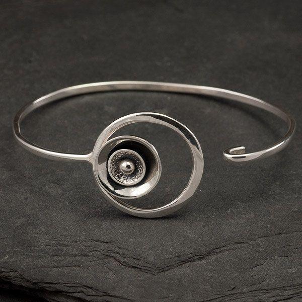 "Sterling Silver Bracelet- Silver Circle Bracelet- Modern Artisan Latch Bracelet- Silver Metalwork Cuff- ""Spherical Disc"". $128.00, via Etsy."