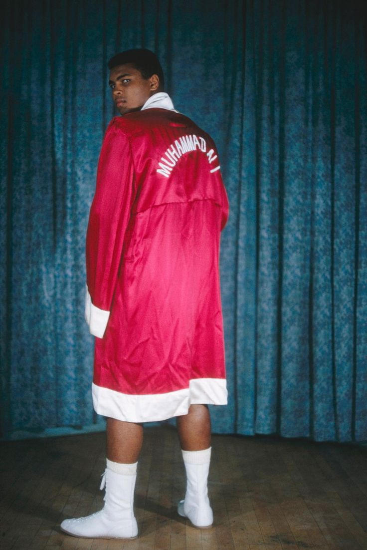 Unstoppable: In 1964, Muhammad Ali poses a portrait in his iconic red robe with his name on it, the same year he became the world heavyweight champion of the world.