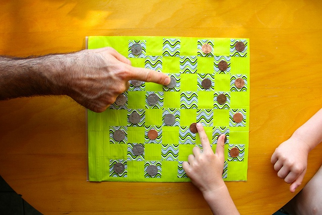 diy duct tape checkerboard... waterproof and doubles as an activity bag!