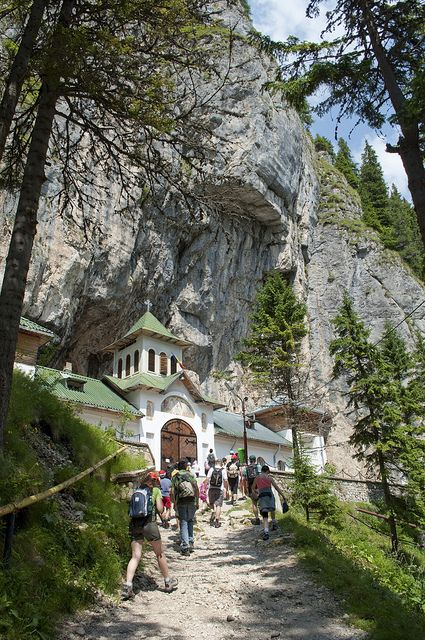 The outside of Pestera Monastery, which has a cave behind it, Romania www.romaniasfriends.com
