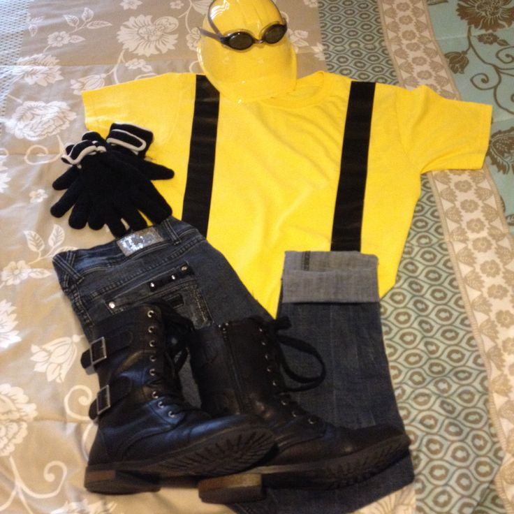 Adult Minion costume. Jeans,yellow tee,black duct tape for suspenders, swim goggles, black boots & black winter gloves. Plastic hard hat from Party City!