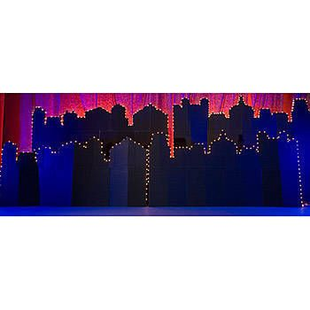 This Lighted City Background allows you to relive the beauty of any memorable city. Our free-standing Lighted City Skyline is made of cardboard and measures 8 ft high x 32 ft wide.