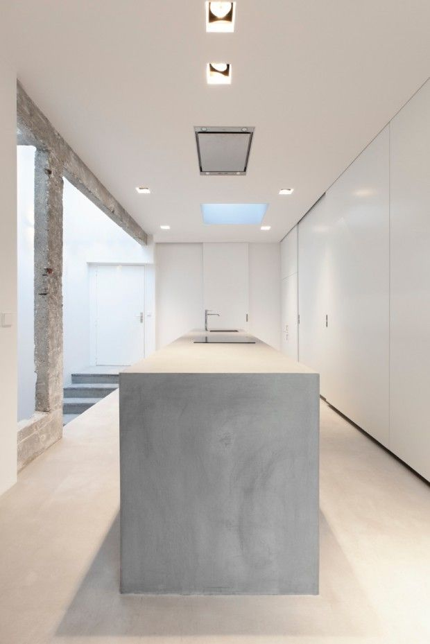 Concrete and white kitchen.