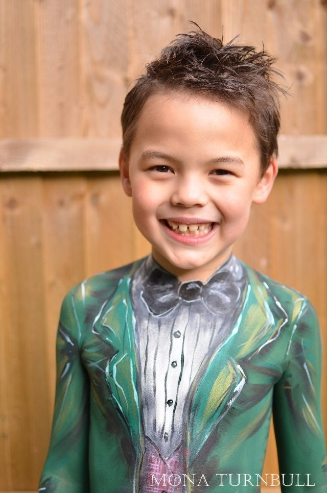 boy gets his body painted