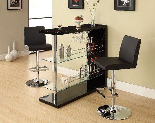 """Bar Table with Two Glass Shelves in Gloss Black Finish by Coaster Home Furnishings. $271.83. Some assembly may be required. Please see product details.. Dining and Kitchen->Bar Stools and Tables->Bar Tables. Dining and Kitchen. Bar Table with Two Glass Shelves in Gloss Black Finish. Dimension: 47.25""""L x 15.75""""W x 44""""H Finish: Gloss Black Material: Metal, Glass Bar Table with Two Glass Shelves in Gloss Black Finish Entertain in style with this sleek contemporar..."""
