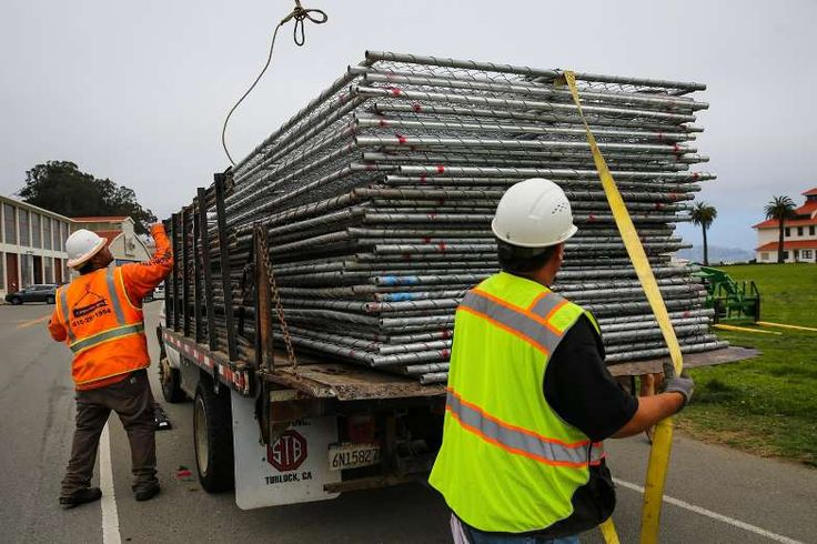 Right-wing rallies at Crissy Field, Berkeley canceled, organizers say   -  August 25, 2017: Workers Mario T. (left) and Raul Marquez (right) prepare to unload a truck full of chain link fences at Crissy Field ahead of Saturday's Patriot Prayer rally in San Francisco, Calif., on Thursday, Aug. 24, 2017.