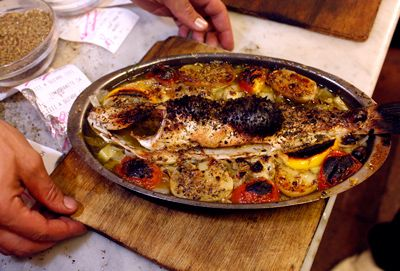 Garlic, coriander, and thyme season this full-flavored baked red snapper, inspired by a similar dish at the restaurant Le Brulot in Antibes.