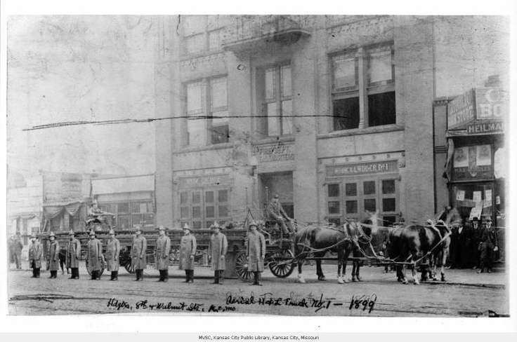 Kansas City Firemen - Exterior street level view of Kansas City firemen in front of the Fire Department Headquarters building which housed Hook & Ladder No.1 and Hose Co. No.2.  Location is 8th and Walnut, Kansas City, Missouri.  1899