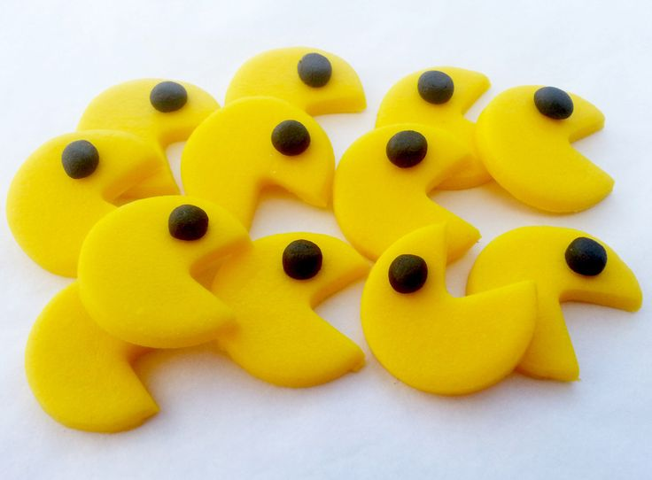 Set of 12 PAC MAN  - edible sugar fondant cake topper decorations each one approx 2.5cm by SugarSugarCakeDecs on Etsy https://www.etsy.com/listing/245421519/set-of-12-pac-man-edible-sugar-fondant