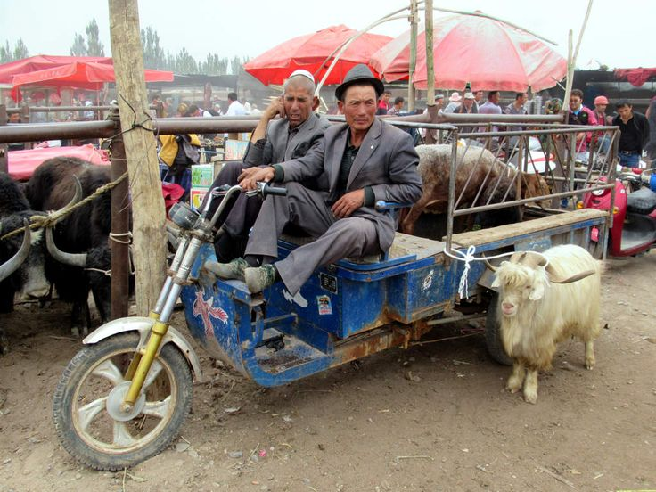 Farmers flock to the Sunday livestock market in a suburb northwest of Kashgar, Xinjiang, China.