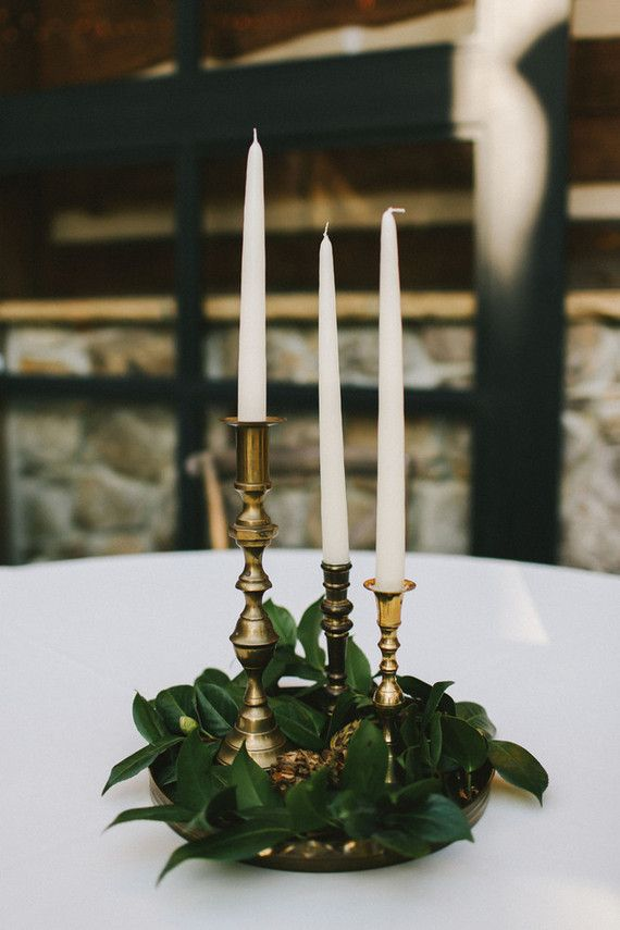 greenery, plain candles, brass