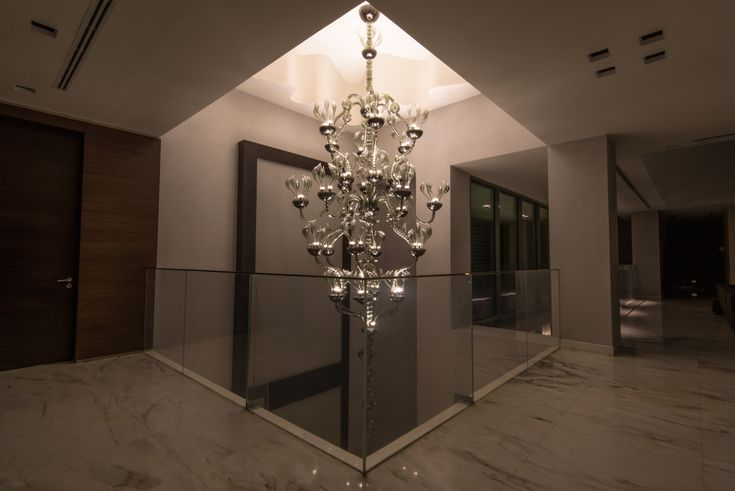 Hand made glass  colour : smoke  finish : sfumato Bulbs : 66 x LED  Height : 6 meters - Ø : 2,2 meters designed by Federico Codato Produced by Vetrarti for FAVOLA  Installed in Dubai - Emirates Hills