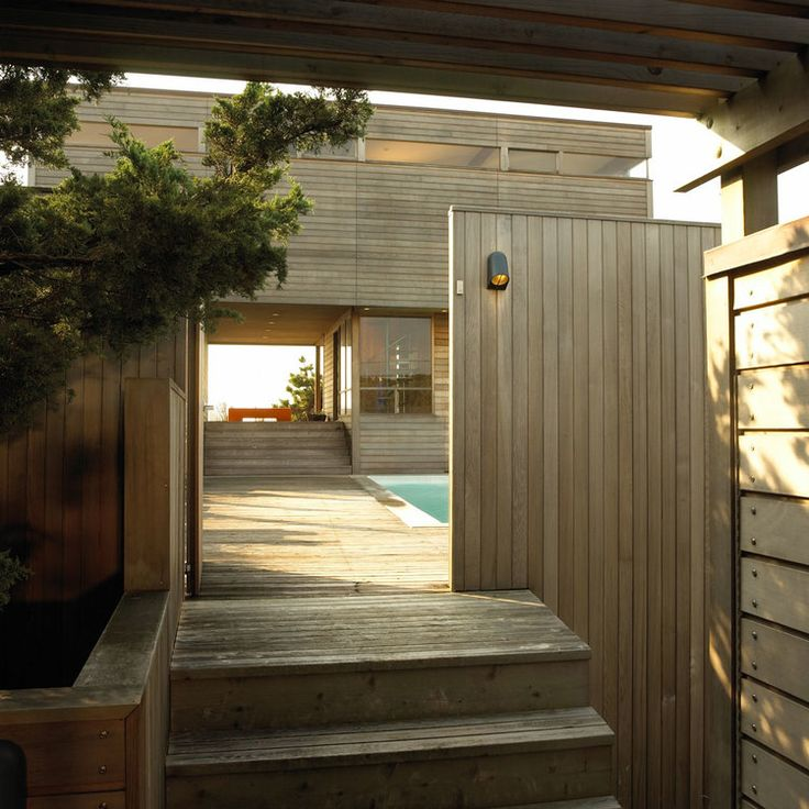 This project was a complete renovation of a 2-story beach front home at Fire Island, New York.  The primary goal of the renovation was to remove any barriers that visually separated the owners from the sea. The deep fascia was removed, transoms were added over the existing bays and more glass was added to the lower level. The project also included planning the house to open the living space, enlarge the kitchen, create a distinct master suite with an ocean front bath, and provide view...