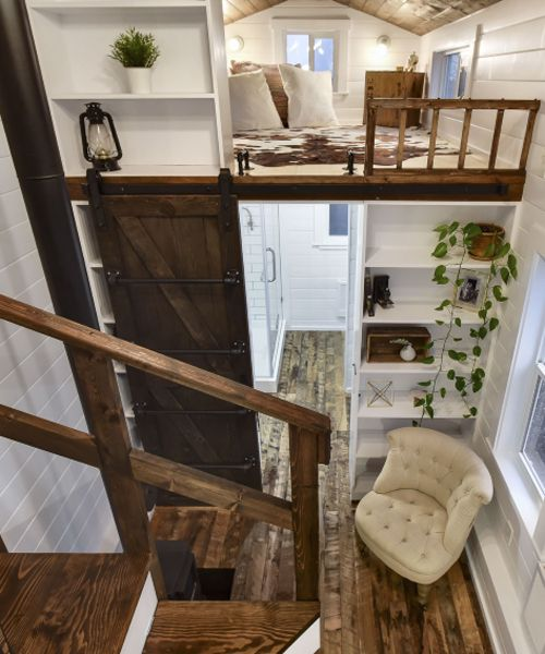 Across from the bedroom loft is a lounging loft that has additional storage space.