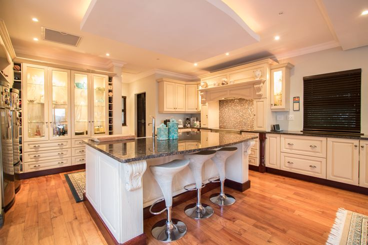 Beautiful white kitchen design with a center island
