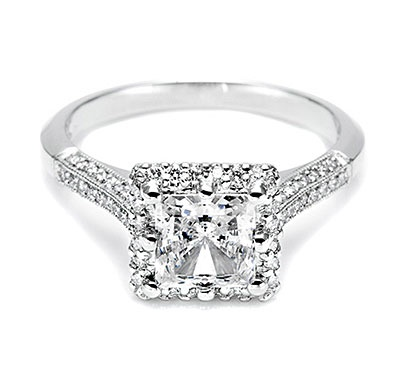 GORGEOUS--platinum and diamond solitaire engagement ring features a princess-cut center stone surrounded by round pave-set diamonds.  2502PRP6