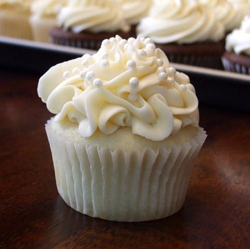 Wedding cake cupcakes! Uses boxed cake mix as one of the ingredients.