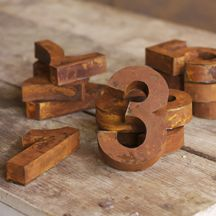 these would make great house numbers for starters, available in zinc and rust finishes
