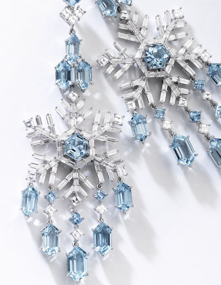 Pair of aquamarine and diamond pendent earrings, Francesco Rosa. Each surmount set with square-cut and fancy-shaped aquamarines accented with square-cut diamonds, supporting a pendant of snowflake design set with a hexagonal aquamarine, square-cut, baguette and whistle-shaped diamonds.