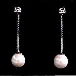 Fistula Foundation: In thanks for your donation of $65 or more, we offer these custom-designed silver-plated Dignity Earrings featuring cultured pearls to express our gratitude for supporting the work of the Foundation.  Your Dignity Earrings (for pierced ears only) are designed to match with the Dignity Necklace and Earrings so they can be worn together or separately.