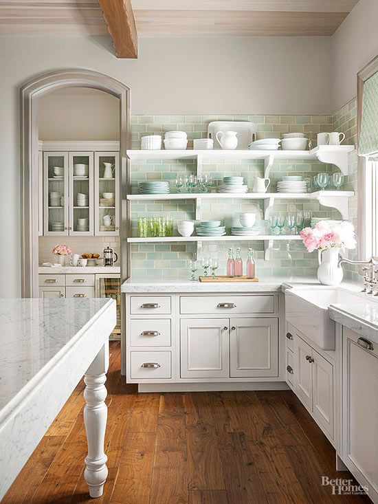 Love the look, colour.  The look of open shelving can be stunning. And you don't have to go full-on open shelves to incorporate the trend. Consider using open shelves in just one corner or around a sink. Afraid you don't have anything display-worthy? Simple white dishes, clear glasses, and colorful cookbooks are kitchens staples that look fabulous on display.