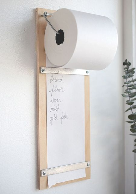 Till rolls allow for a smaller grocery list that can easily be mounted onto a scrap piece of plywood or other board. The grocery list below is held in place using a couple of eye hooks and some medium-gauge wire.